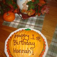 Birthday/halloween Cake This was just two yellow rounds with white icing, sprayed with the Wilton Color spray (orange), a little round/curly q thing for the stem...