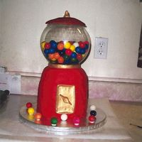 Gumball_Machiene.jpg The gumballs are real! The globe was a fish bowl. Stacked rounds covered with fondant.