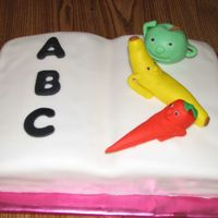 A B C Book This cake is covered in Fondant with fondant fruits and carrot.Fondant letters.I gave this to the school for the cake walk at the fall...