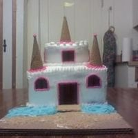 Castle Cake   This is a cake I made for a 1 yr old little girl's birthday. She is a child in my daycare class and I made as a gift to her.