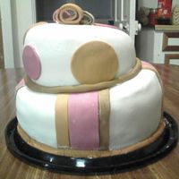 Topsy_Turvy_Cake.jpg  This is my first shot at a topsy turvey cake. I don't know why my fondant always looks so messy. Anyway I was in a hurry and sick, I...