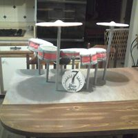 Drumset From The Front   Here is the front view of the drumset cake. 7 Days Away is the name of his band