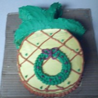 Hawaiian Christmas Cake   This is a cake I made for our staff Christmas Party. The party theme was An Hawaiian Christmas. It is pineapple cake with buttercream.