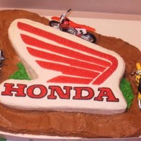 Honda/ Racetrack This was for my nephew's 8th birthday. He just got a Honda dirt bike for Christmas so his parents wanted his cake to have something to...