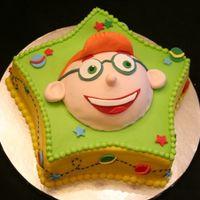 Leo-Little Einsteins   2 layer cake iced with BC. Fondant accents. Leo is mini ball pan covered with fondant.Thanks for looking