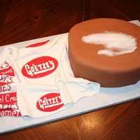 "Caramel Cream Did this cake for my office. I wanted to wrap the cake with the ""wrapper"" but couldn't get it right so I settled for a..."