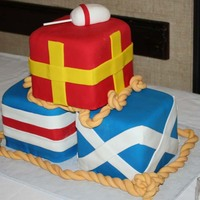 Nautical Flags  This was for a wedding with a nautical theme. Each flag is 6x6x6 and covered in fondant and each represents a letter of the groom's...
