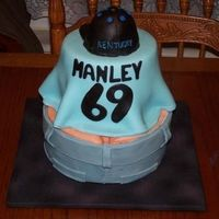 30Th Birthday Cake A cinnamon bun cake, frosted with cream cheese icing. Covered with MMF. All of the decorations are MMF. Jeans on the bottom, his volleyball...