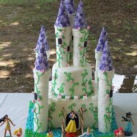 Princess Castle Cake Dark chocolate cake filled with fudge frosting. Covered in MMF. The towers are paper towel rolls covered in fondant, the spires are ice...