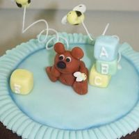Baby Bear With Blocks And Bees, Sitting On A Blanket Fondant spiked with Tylose Powder to make it dry harder like GP. Topper for a baby shower cake. I used Aine2's tutorials for...