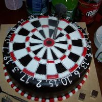 Dartboard A copy of Steponmi's fabulous Dartboard Cake. French vanilla cake filed and frosted with vanilla bean butter cream. Covered in...