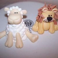 The Lion And The Lamb A lion and a lamb made for a Chrsitening cake. The lion I tweaked on my own, but Aine2's lamb tutorial on youtube was the inspiration...