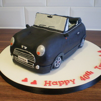 Mini Cooper Cake this was my second try at a carved car cake. this one came out so much better than the first. it took me about 17 hours to get this done, i...