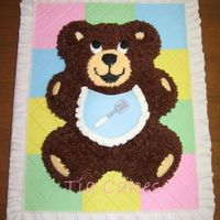 Baby Bear I got this idea from the 2008 Wilton yearbook. The quilt is fondant and I used the Wilton fondant tool to make the seams in the quilt. The...