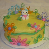 Quilled Flowers And Hello Kitty Birthday I made this cake for my mom for her birthday. She loves Hello Kitty so my sister made Hello Kitty out of fondant as a topper for the cake....
