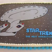 Star Trek: The Next Generation Enterprise My mom and I teamed up on this cake for my birthday. I LOVE Star Trek: TNG. I cut the Enterprise out of gray Wilton fondant and painted it...