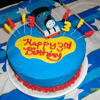 "Thomas Theme 3Rd Birthday Cake All bc except for the yellow ""bubble"" and the little swirls and 3's stuck in the cake."