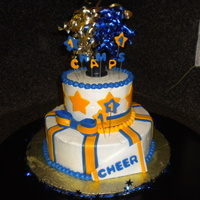 Cheer!! This was made for cheerleaders who won a championship.....fondant decorations