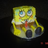 Spongebob Practice Cake  Made this cake to try what i've seen here on CC. I think i'll make him taller next time and maybe cover him in fondant. My kids...