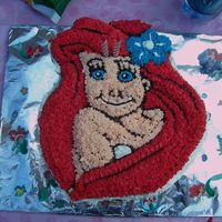 Ariel I had to decorate this in 30 mins. so the lips are not the color I wanted. But it was my first cake ever.