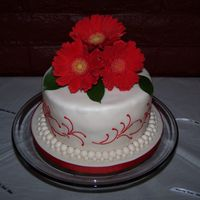 Gerber Daisy Cake This is an 8 in round cake approx 4 in high. It is gluten free, made with the Betty Crocker mix. It took 3 boxes. Covered in fondant with...