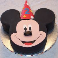 Mickey Mouse Cake 10 inch head and 6 inch ear cakes covered in fondant. Hat is a real party hat covered in fondantClient came earlier than expected and I was...