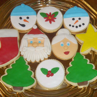 Christmas Cookies 2009! All NFSC decorated in fondant. Santa and snowmen inspired by many CCers! Thanks!