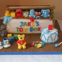 Toy Box Cake I made this Toy box cake for a baby's 1st birthday. Everything is edible, the baby shoes and toys etc were made out of fondant/...