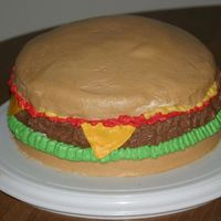 Cheeseburger Cake  My first cheeseburger cake! I'm so excited about this one! It's a chocolate and vanilla cake, using the Wilton checkerboard pan....