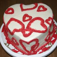 Valentine's Cake Dark chocolate fudge cake with strawberry filling and white chocolate buttercream. Brushed embroidery hearts. I used 2 sizes of cookie...