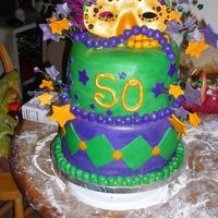 Mardi Gras 50Th Birthday White Cake w/fresh strawberry filling. Covered in fondant w/gumpaste accents.