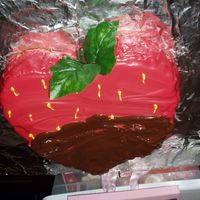 Chocolate Dipped Strawberry Strawberry cake baked in a heart shaped pan with red, yellow, and chocolate candy melts. This was for my daughter's third birthday!...