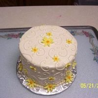 Yellow Daisies This is another special occasion cake that I did for my parent's bed and breakfast guests. It is in buttercream with fondant daisies,...
