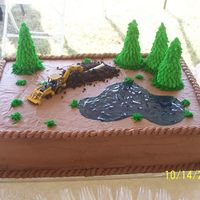 Chocolate Groom's Cake This was the groom's cake that I did. It is chocolate fudge with mocha icing. The groom has a backhoe service so that is what the...