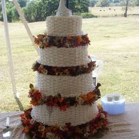 Fall Wedding Cake This was the first wedding cake I have ever done. I did it for my sister's wedding using the wilton tall tiers stand. It is done in...