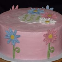 "Daisy Cake   2 layers (12"") of zebra cake, iced in light pink buttercream and topped with fondant daisies."