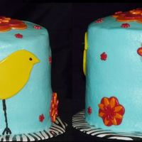 "Little Bird And Flower Cake  This was a little cake I made for a friend. 2 layers of 5"" zebra cake, iced in turquoise buttercream. Yellow fondant bird and red and..."
