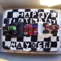Checker Flag Monster Truck Cake   This was my son's 2nd birthday party. My son loved it. Everyone thought it was really cool. The ramps are made out of cake.
