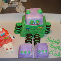 Birthday Robot Cake A large and small robot birthday cake