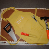 A Carpenter's 80Th Birthday A sheet cake for an 80th birthday. Carpenter's apron out of fondant with play tools to accent.