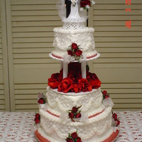 Red/ White Heart Tiered Wedding Cake Heart Shaped Tiers in Red and White. Silk flowers made this last minute cake beautiful