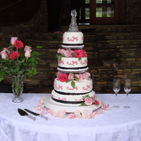 "Black, White, And ""watermelon"" Red Wedding Cake The red was actually matched to the bride's maid's dresses. The columns were originally 6"" to make the cake taller. But the..."