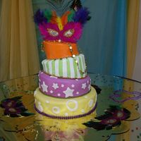 Mardi Gras Quinceanero Four tier topsy turvy cake, covered in fondant with a MardiGras theme (just not the traditional colors)