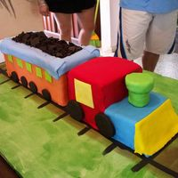 Fondant 3D Train 3D train covered in fondant, dark chocolate cookies for wheels and coal