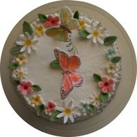 Butterflies And Flowers Very simple cake, with gumpaste flowers and butterflies floating above on curled florist wire