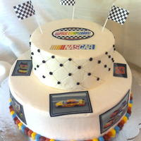 "Nascar Car 29 Cake Two tier BC iced cake. Pictures are printed on icing sheet. Border and ""quilting"" done in BC. Flags are plastic decorations."