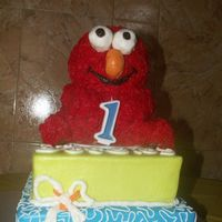 "3D Elmo Birthday Cake BC covered 3D cake Elmo on top of 8"" and 10"" square cakes in BC. For a baby's 1st birthday. The Elmo was carved from the 3D..."