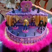 Bratz Birthday Stage cake with Bratz performers. Mock whip frosting, airbrushed, with fondant accents.