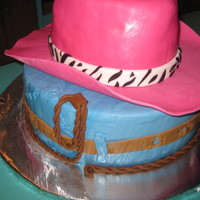 Pink Cowgirl Hat cake for my goddaughter 11th bday. for the hat 3 8in stack cakes and shape like a cowboy hat. covered in mmf. bottom is 2 12 in cake...
