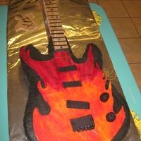 Guitar With Flames  single layer cake, choc. buttercream tinted black, the neck is made out of rkt, I had problems with the neck had to put a piece of styfroam...